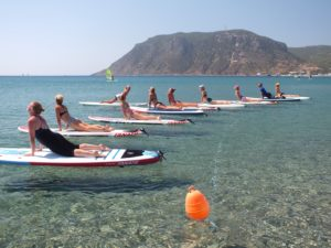 The calm waters of Kamari Bay are great for paddle board yoga.