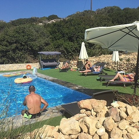 Family enjoying The Tower House pool