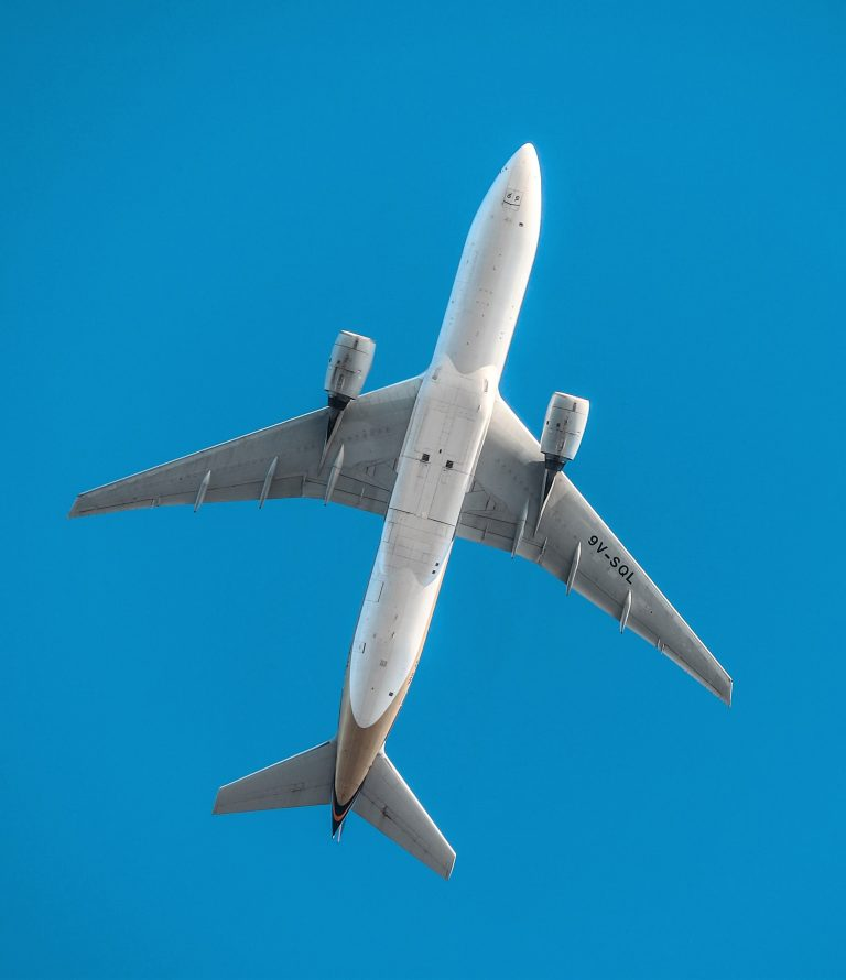 Aeroplane flying in blue sky